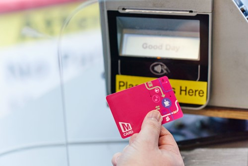 Pink MCard being used on a bus